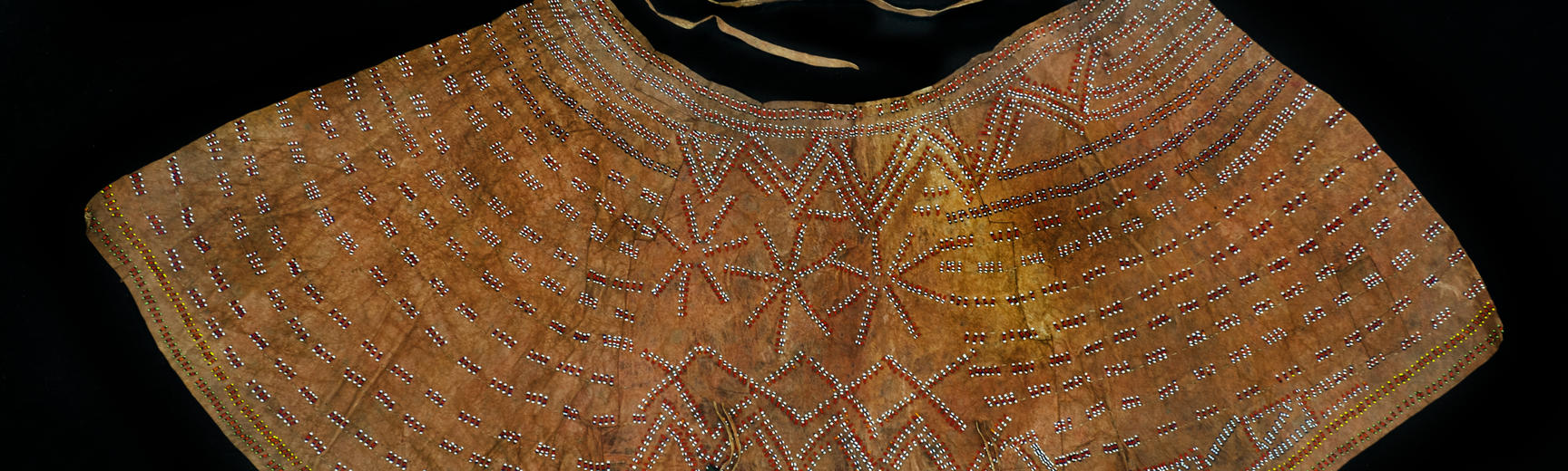 Beaded hide skirt. Donated by Elizabeth Porter.