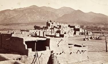 Multi-storeyed houses in Taos Pueblo, a settlement which has been inhabited for over six centuries and is the northernmost of the Rio Grande pueblos. Photograph by John Hillers. Taos, New Mexico, United States of America. 1880.