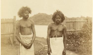 Portrait of two Fijian men, labourers, pictured beside the Rewa River. Photograph by Alfred Burton for the Burton Brothers studio (Dunedin). Viti Levu, Fiji. June 1884.