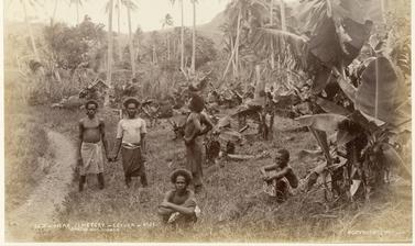 Fijian men near the cemetery at Levuka. Photograph by Alfred Burton for the Burton Brothers studio (Dunedin). Levuka, Ovalau, Fiji. 14 July 1884.