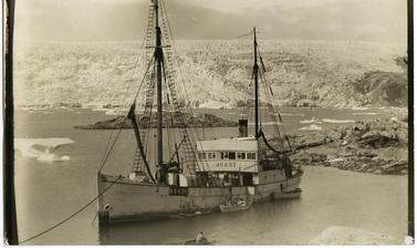 The British Arctic Air-Route Expedition group arrived in Greenland on the Quest. Photograph by Henry Iliffe Cozens. Base Fjord, Greenland. 1930–1931.