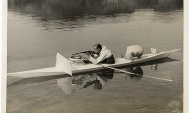 The white screen at the front of the kayak was used to help disguise the hunter from unsuspecting seals in the water. Photograph by Henry Iliffe Cozens. Greenland. 1930–1931.