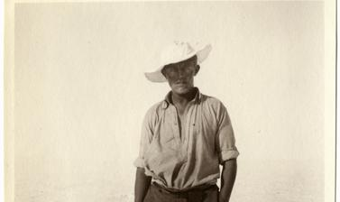 Portrait of expedition member Alfred Stephenson wearing snowshoes. Photograph by Henry Iliffe Cozens. Greenland. 1930–1931.