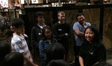 Nyema Droma discussing her work with teenage members of the UK's Tibetan community during a public engagement event, 'My Tibet Museum', held at the Pitt Rivers Museum in October 2018.