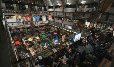 A crowded audience of Tibetans and others watch a video message from Nyema Droma at a public engagement event held at the Pitt Rivers Museum in April 2019.