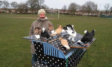 'Pigeon Pete' (Peter Petravicius) trains his birds to recognise their mobile pigeon loft from the air: 'For this purpose we decorated our pigeon loft with a distinctive black with white polka dots design.'