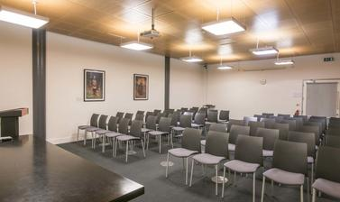 Meeting room with rows of chairs
