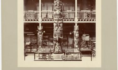 Interior view of the Pitt Rivers Museum, looking towards the east end of the Court, showing the Haida totem pole ('Star House Pole'). Photograph by Alfred Robinson. Oxford, England. 1901. (Copyright Pitt Rivers Museum, University of Oxford. Accession Numb