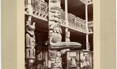 Interior view of the Pitt Rivers Museum, taken towards the east end of the Court, showing the lower part of the Haida totem pole ('Star House Pole'). Photograph by Alfred Robinson. Oxford, England. 1901. (Copyright Pitt Rivers Museum, University of Oxford