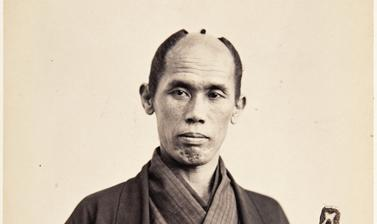 Portrait of Ikuta Nozawa, domestic attendant of one of the assistant envoys, carrying long and short swords (katana and wakizashi). Photograph by Jacques-Philippe Potteau. Paris, France. 1862. (Copyright Pitt Rivers Museum, University of Oxford. Accession