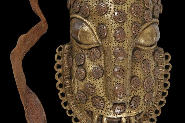 Brass leopard mask covered in raised bumps to represent the spots on leopard skin