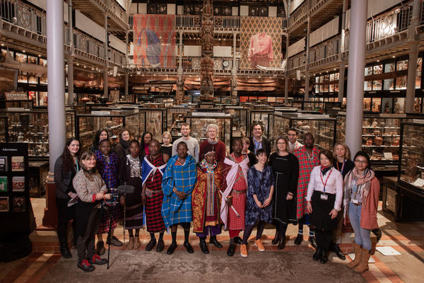 Staff and Maasai visitors in Pitt Rivers Museum